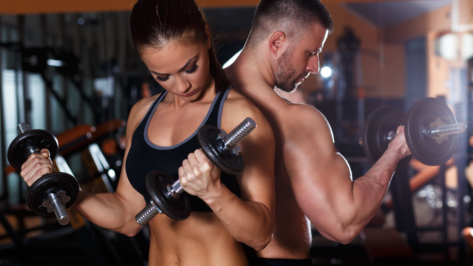 girl and bodybuilder in the gym
