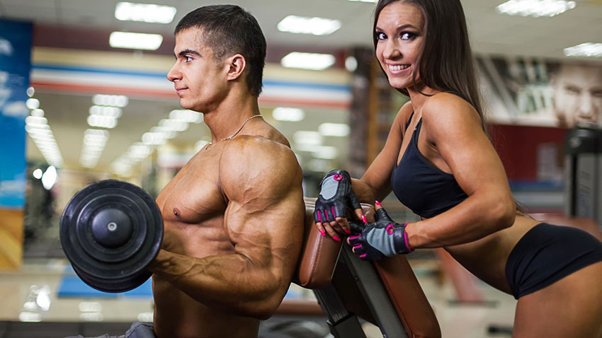 Bodybuilder and girl in the gym
